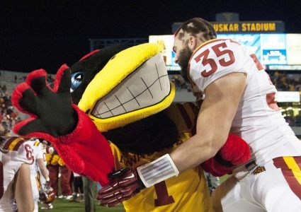 Nov 30, 2013; Morgantown, WV, USA; Iowa State Cyclones defensive back Levi Peters (35) hunts the Iowa State Cyclones mascot after the defense held West Virginia Mountaineers scoreless in the third overtime at Milan Puskar Stadium. Iowa State Cyclones defeated West Virginia Mountaineers 52-44 in the third overtime. Mandatory Credit: Tommy Gilligan-USA TODAY Sports