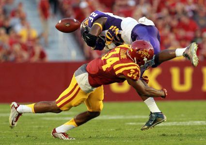 Sep 5, 2015; Ames, IA, USA; Iowa State Cyclones defensive back Nigel Tribune (34) forces a fumble on Northern Iowa Panthers running back Tyvis Smith (32) at Jack Trice Stadium. Mandatory Credit: Reese Strickland-USA TODAY Sports