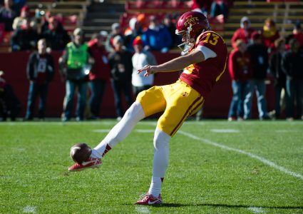 Nov 1, 2014; Ames, IA, USA; Iowa State Cyclones punter Colin Downing (13) kicks against the Oklahoma Sooners at Jack Trice Stadium. Oklahoma defeated Iowa State 59-14. Mandatory Credit: Steven Branscombe-USA TODAY Sports