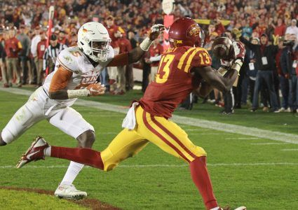 Oct 31, 2015; Ames, IA, USA; Iowa State Cyclones wide receiver Dondre Daley (13) catches a touchdown pass in the third quarter in front of Texas Longhorns defensive back Holton Hill (5) at Jack Trice Stadium. The Cyclones beat the Longhorns 24-0.  Mandatory Credit: Reese Strickland-USA TODAY Sports