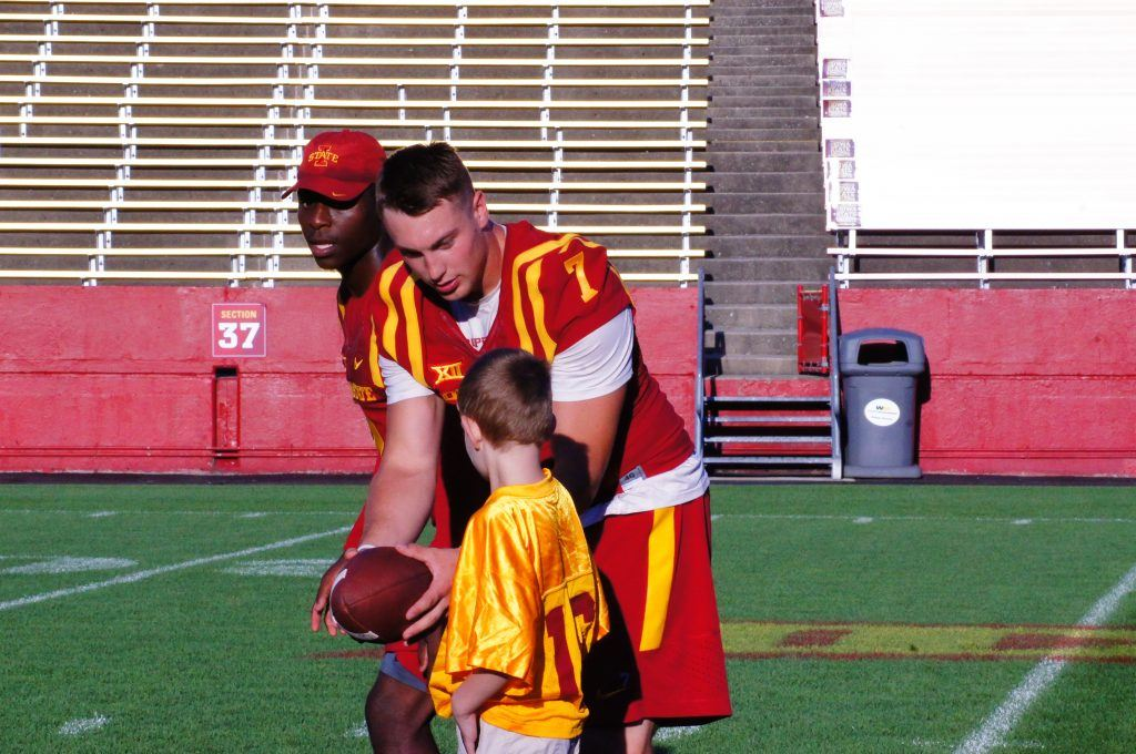 Joel Laning hands off for a touchdown as Mike Warren leads the way at ISU's Victory Day on Aug. 27, 2016.