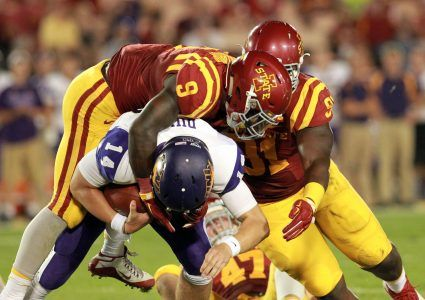 Sep 5, 2015; Ames, IA, USA; Northern Iowa Panthers quarterback Eli Dunne (14) is sacked by Iowa State Cyclones linebacker Reggan Northrup (9) and defensive lineman Pierre Aka (91) at Jack Trice Stadium. The Cyclones beat the Panthers 31-7.  Mandatory Credit: Reese Strickland-USA TODAY Sports