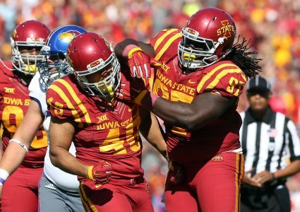 Oct 3, 2015; Ames, IA, USA; Iowa State Cyclones defensive lineman Demond Tucker (97) and defensive end Dale Pierson (45) celebrate a touchdown against the Kansas Jayhawks at Jack Trice Stadium. Mandatory Credit: Reese Strickland-USA TODAY Sports