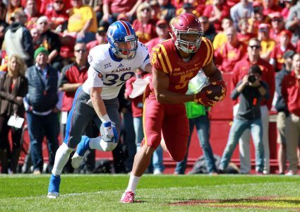 Oct 3, 2015; Ames, IA, USA; Iowa State Cyclones wide receiver Allen Lazard (5) catches a touchdown pass in front of Kansas Jayhawks safety Michael Glatczak (39) at Jack Trice Stadium. Mandatory Credit: Reese Strickland-USA TODAY Sports