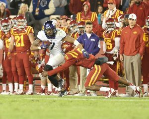 Oct 17, 2015; Ames, IA, USA; Iowa State Cyclones defensive back Kamari Cotton-Moya (5) tackles TCU Horned Frogs wide receiver Kolby Listenbee (7) during the fourth quarter at Jack Trice Stadium. The Horned Frogs beat the Cyclones 45-21. Mandatory Credit: Reese Strickland-USA TODAY Sports