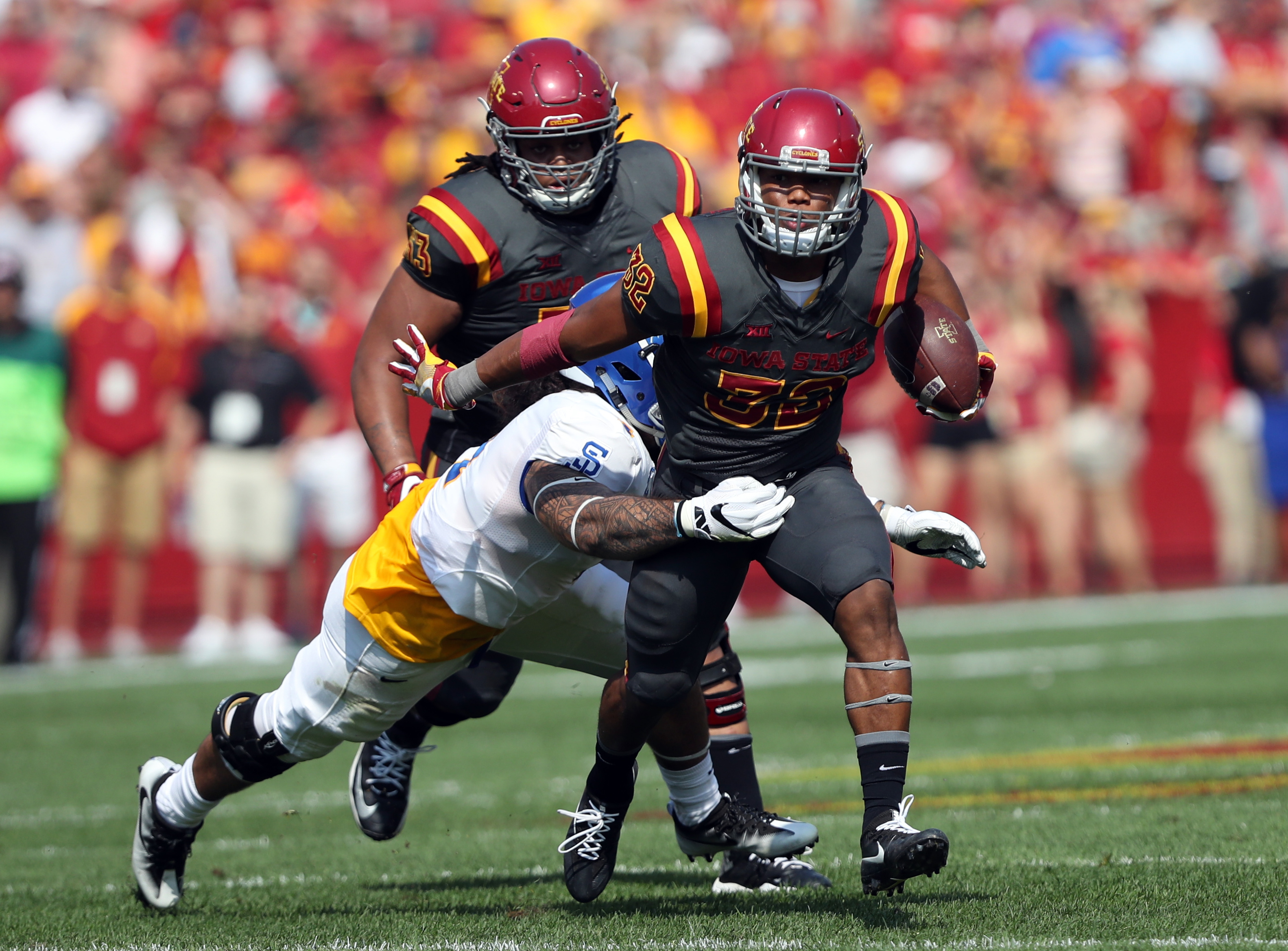 Sep 24, 2016; Ames, IA, USA; Iowa State Cyclones running back David Montgomery (32) carries the football against the San Jose State Spartans at Jack Trice Stadium. Mandatory Credit: Reese Strickland-USA TODAY Sports