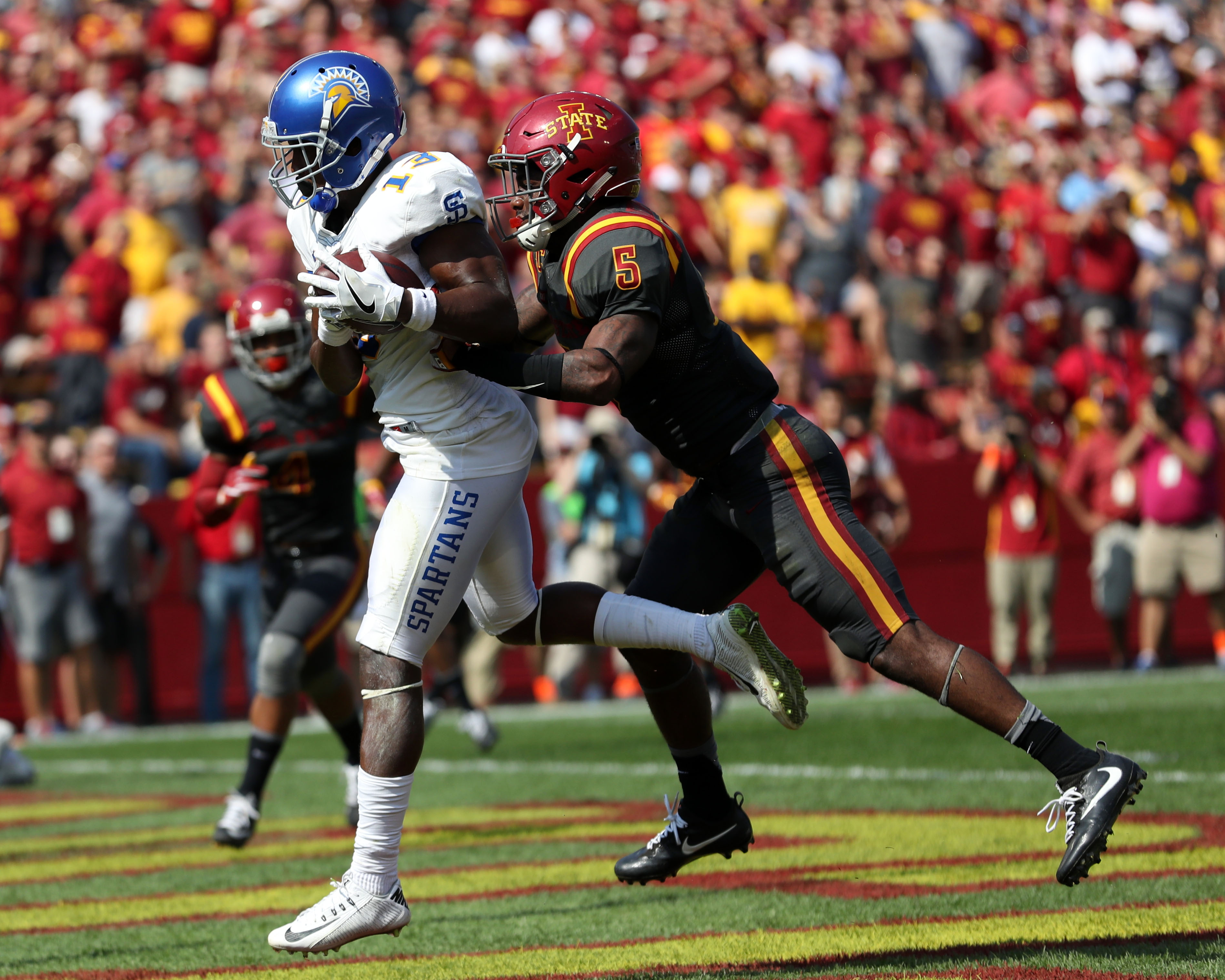 Sep 24, 2016; Ames, IA, USA; San Jose State Spartans wide receiver Tre Hartley (13) catches a touchdown pass in front of Iowa State Cyclones defensive back Kamari Cotton-Moya (5) at Jack Trice Stadium. Mandatory Credit: Reese Strickland-USA TODAY Sports