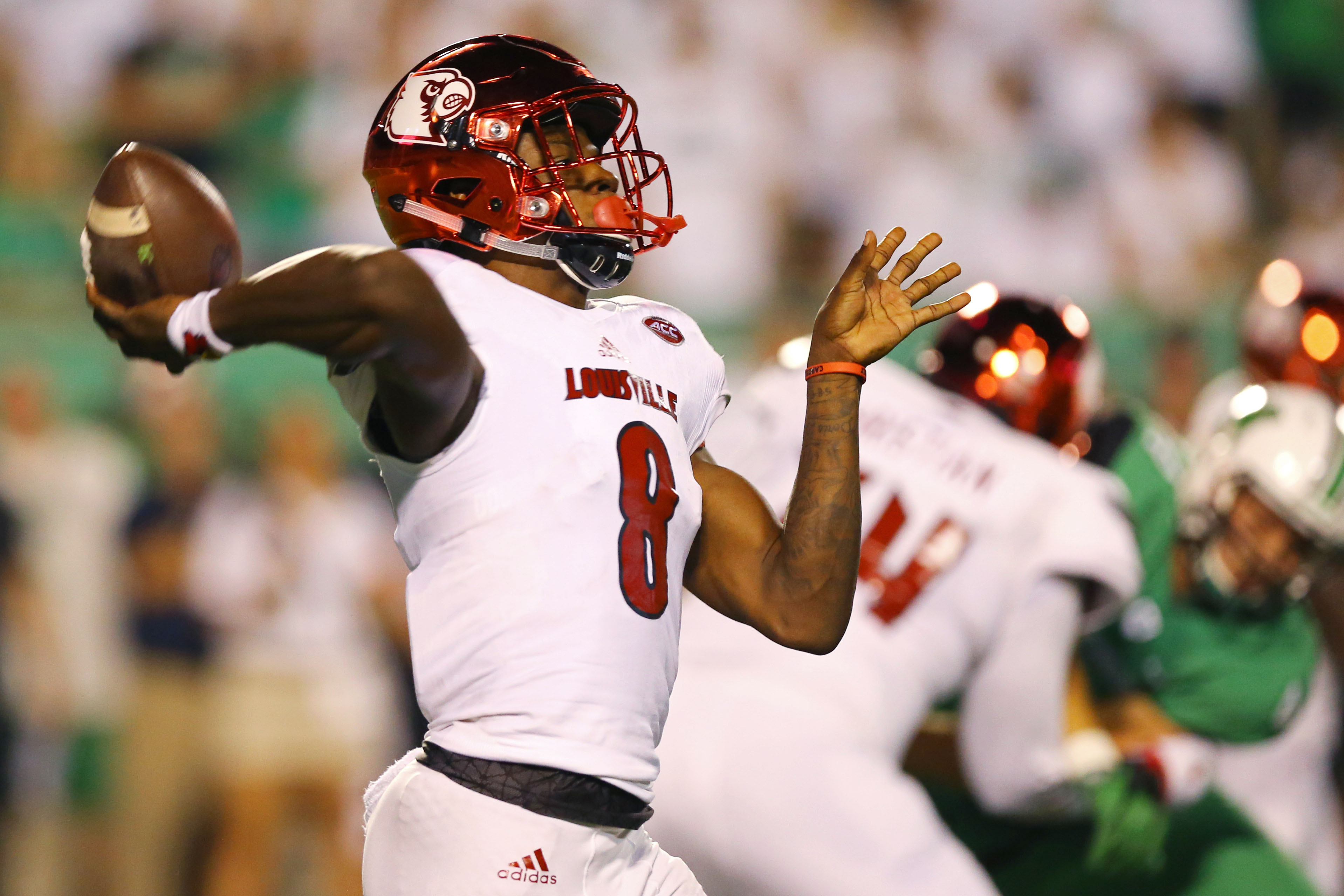 Sep 24, 2016; Huntington, WV, USA; Louisville Cardinals quarterback Lamar Jackson (8) throws a pass for a touchdown to wide receiver James Quick (not pictured) against the Marshall Thundering Herd in the first half at Joan C. Edwards Stadium. Mandatory Credit: Aaron Doster-USA TODAY Sports