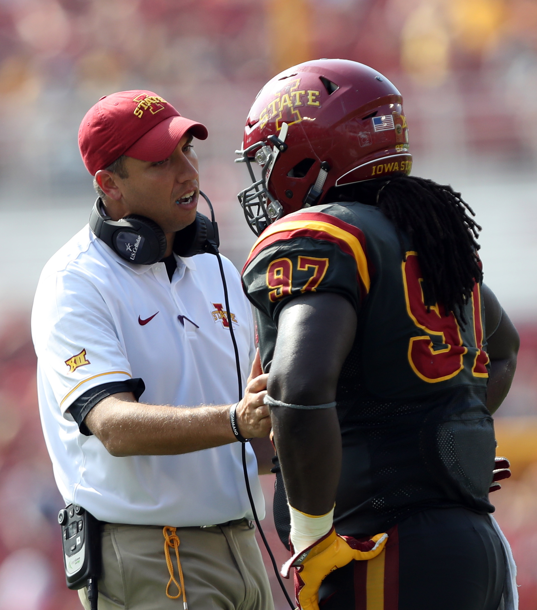 Sep 24, 2016; Ames, IA, USA; Iowa State Cyclones head coach Matt Campbell talks to Iowa State Cyclones defensive lineman Demond Tucker (97) during their game against the San Jose State Spartans at Jack Trice Stadium. Mandatory Credit: Reese Strickland-USA TODAY Sports