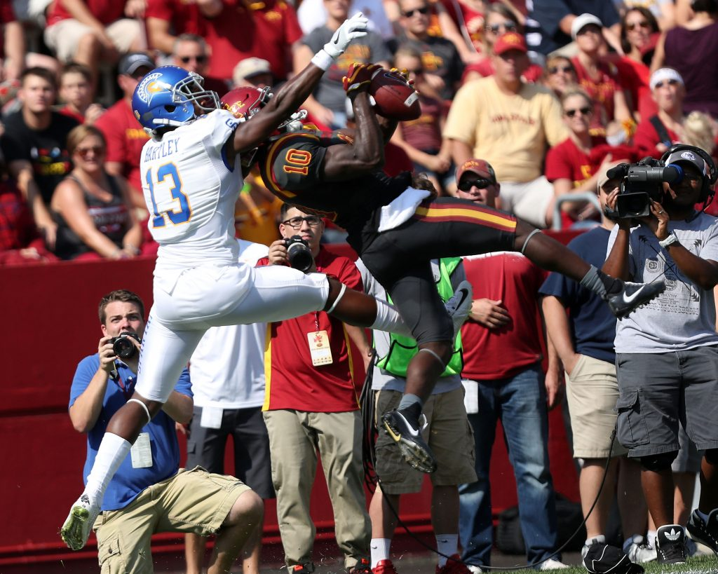 Sep 24, 2016; Ames, IA, USA; Iowa State Cyclones defensive back Brian Peavy (10) intercepts a pass in front of San Jose State Spartans wide receiver Tre Hartley (13) at Jack Trice Stadium. Mandatory Credit: Reese Strickland-USA TODAY Sports