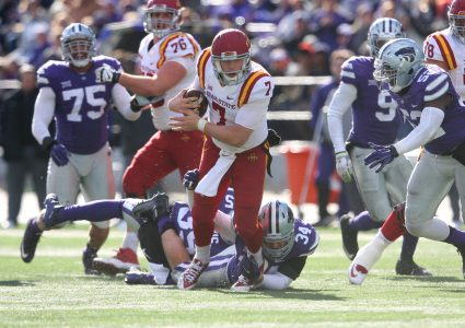Nov 21, 2015; Manhattan, KS, USA; Iowa State Cyclones quarterback Joel Lanning (7) breaks away from Kansas State Wildcats defensive end Tanner Wood (34) during a game at Bill Snyder Family Football Stadium. The Wildcats won, 38-35. Mandatory Credit: Scott Sewell-USA TODAY Sports