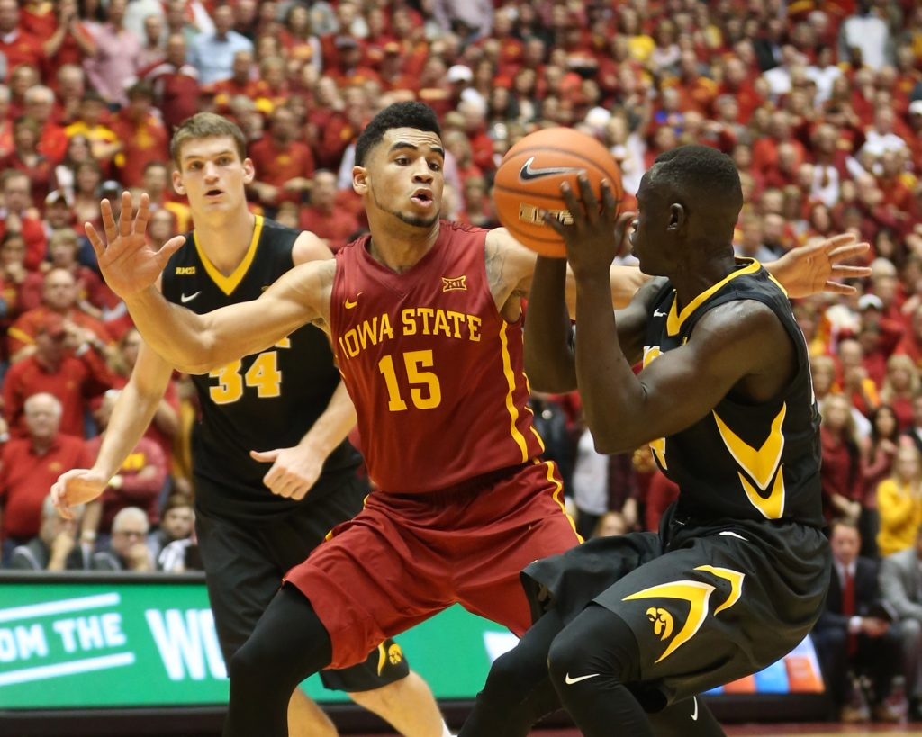 Dec 10, 2015; Ames, IA, USA; Iowa State Cyclones guard Nazareth Mitrou-Long (15) defends Iowa Hawkeyes guard Peter Jok (14) at James H. Hilton Coliseum. The Cyclones beat the Hawkeyes 83-82. Mandatory Credit: Reese Strickland-USA TODAY Sports