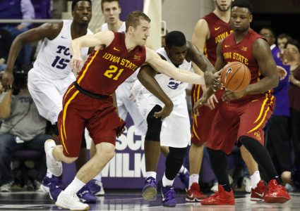 Jan 23, 2016; Fort Worth, TX, USA; Iowa State Cyclones guard Matt Thomas (21) and TCU Horned Frogs forward Chris Washburn (33) battle for the loose ball during the second half at Ed and Rae Schollmaier Arena. Iowa State won 73-60. Mandatory Credit: Ray Carlin-USA TODAY Sports