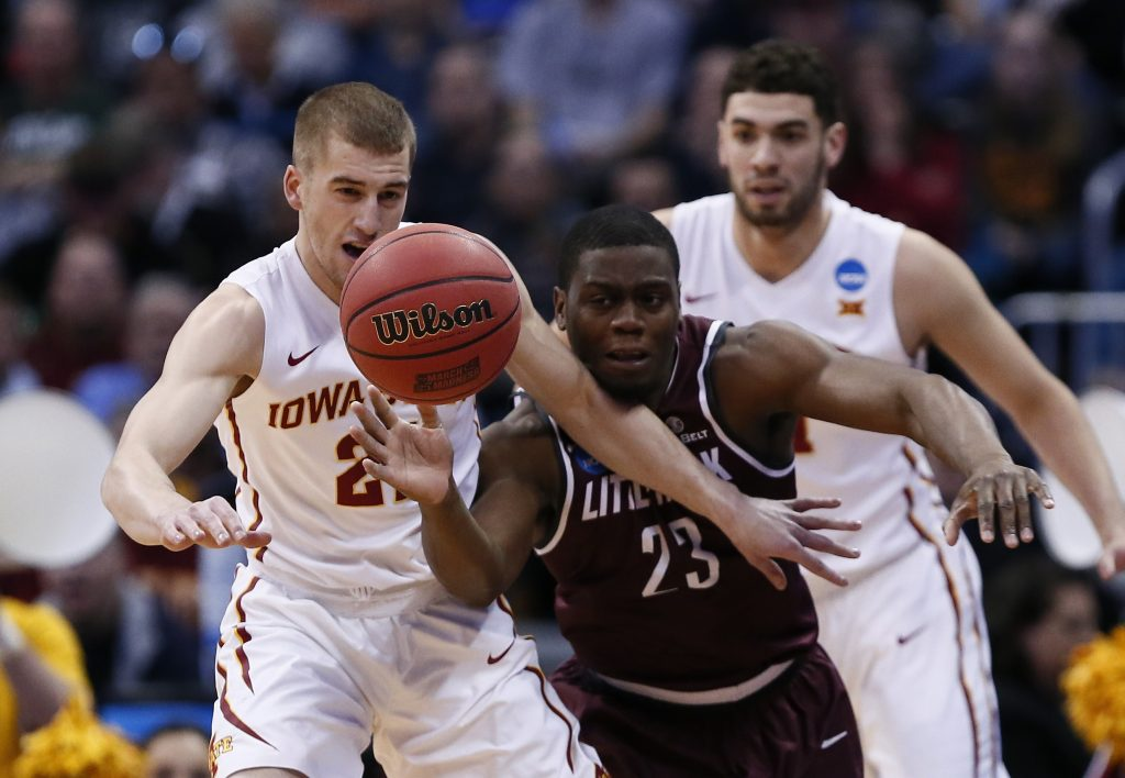 Mar 19, 2016; Denver , CO, USA; Iowa State Cyclones guard Matt Thomas (21) and Arkansas Little Rock Trojans guard Kemy Osse (23) scramble for a loose ball early in first half action of Iowa State vs Arkansas Little Rock during the second round of the 2016 NCAA Tournament at Pepsi Center. Mandatory Credit: Isaiah J. Downing-USA TODAY Sports