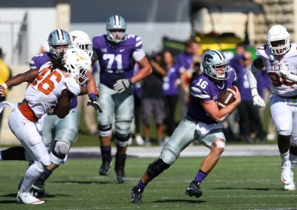 Oct 22, 2016; Manhattan, KS, USA; Kansas State Wildcats quarterback Jesse Ertz (16) finds room to run against the Texas Longhorns defense during a game at Bill Snyder Family Football Stadium. The Wildcats won, 24-21. Mandatory Credit: Scott Sewell-USA TODAY Sports
