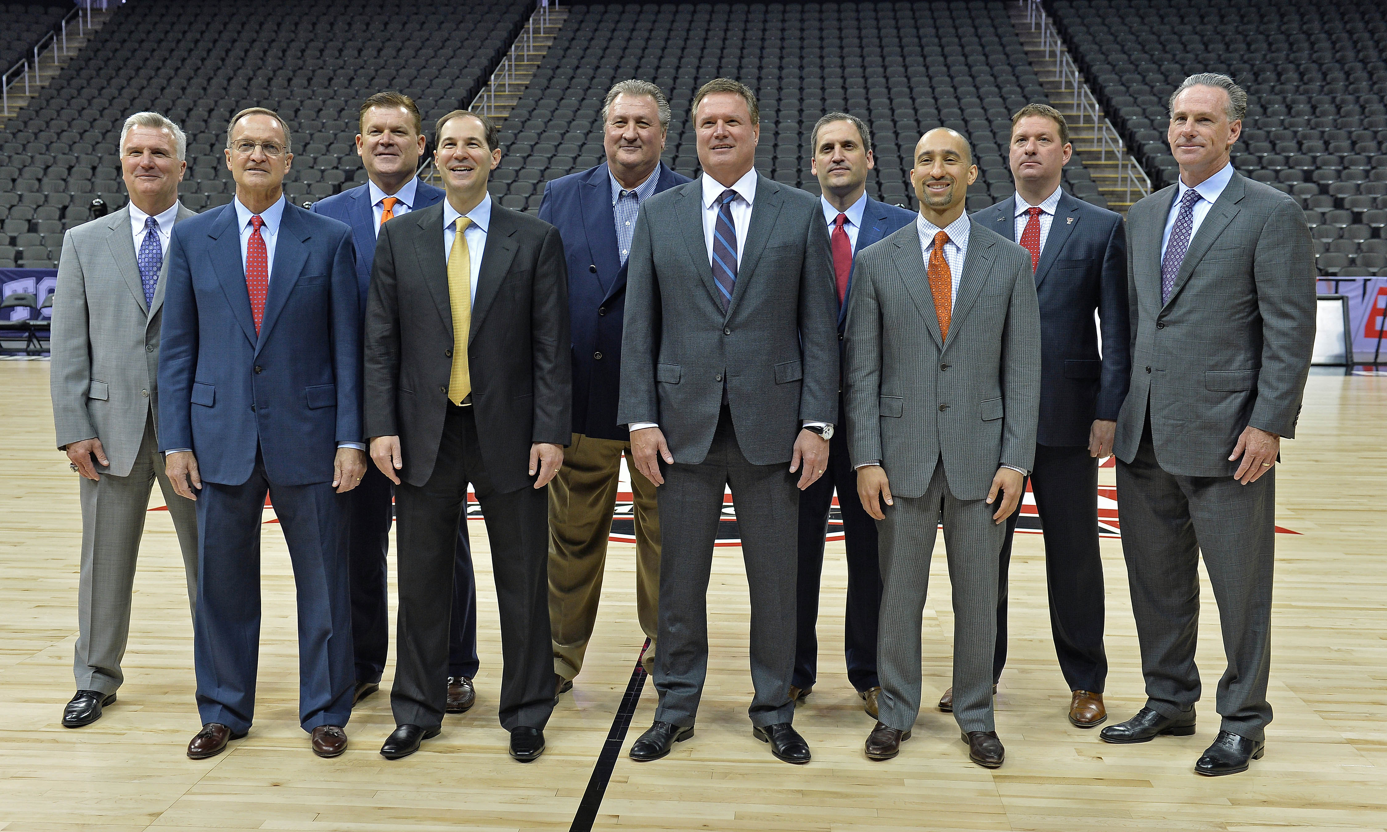 Oct 25, 2016; Kansas City, MO, USA;  Big 12 head coaches (from left to right) Bruce Weber from Kansas State, Lon Kruger from Oklahoma, Brad Underwood from Oklahoma State, Scott Drew from Baylor, Bob Huggins from West Virginia, Bill Self from Kansas, Steve Prohm from Iowa State, Shaka Smart from Texas, Chris Beard from Texas Tech and Jamie Dixon from TCU, pose for a group photo during the Big 12 Basketball Media Day at the Sprint Center. Mandatory Credit: Peter G. Aiken-USA TODAY Sports