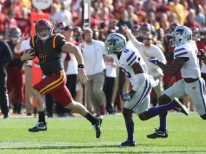 Oct 29, 2016; Ames, IA, USA; Iowa State Cyclones quarterback Joel Lanning (7) runs away from Kansas State Wildcats defensive back Duke Shelley (8) and defensive back DJ Reed (2) for a first down at Jack Trice Stadium. The Wildcats beat the Cyclones 31-26. Mandatory Credit: Reese Strickland-USA TODAY Sports