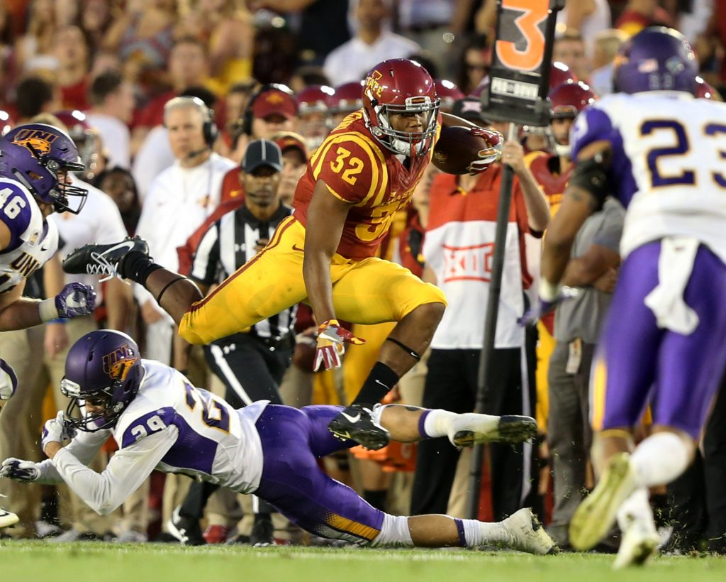 Sep 3, 2016; Ames, IA, USA; Iowa State Cyclones running back David Montgomery (32) hurdles Northern Iowa Panthers defensive back Jamison Whiting (29) during the first half at Jack Trice Stadium. Mandatory Credit: Reese Strickland-USA TODAY Sports