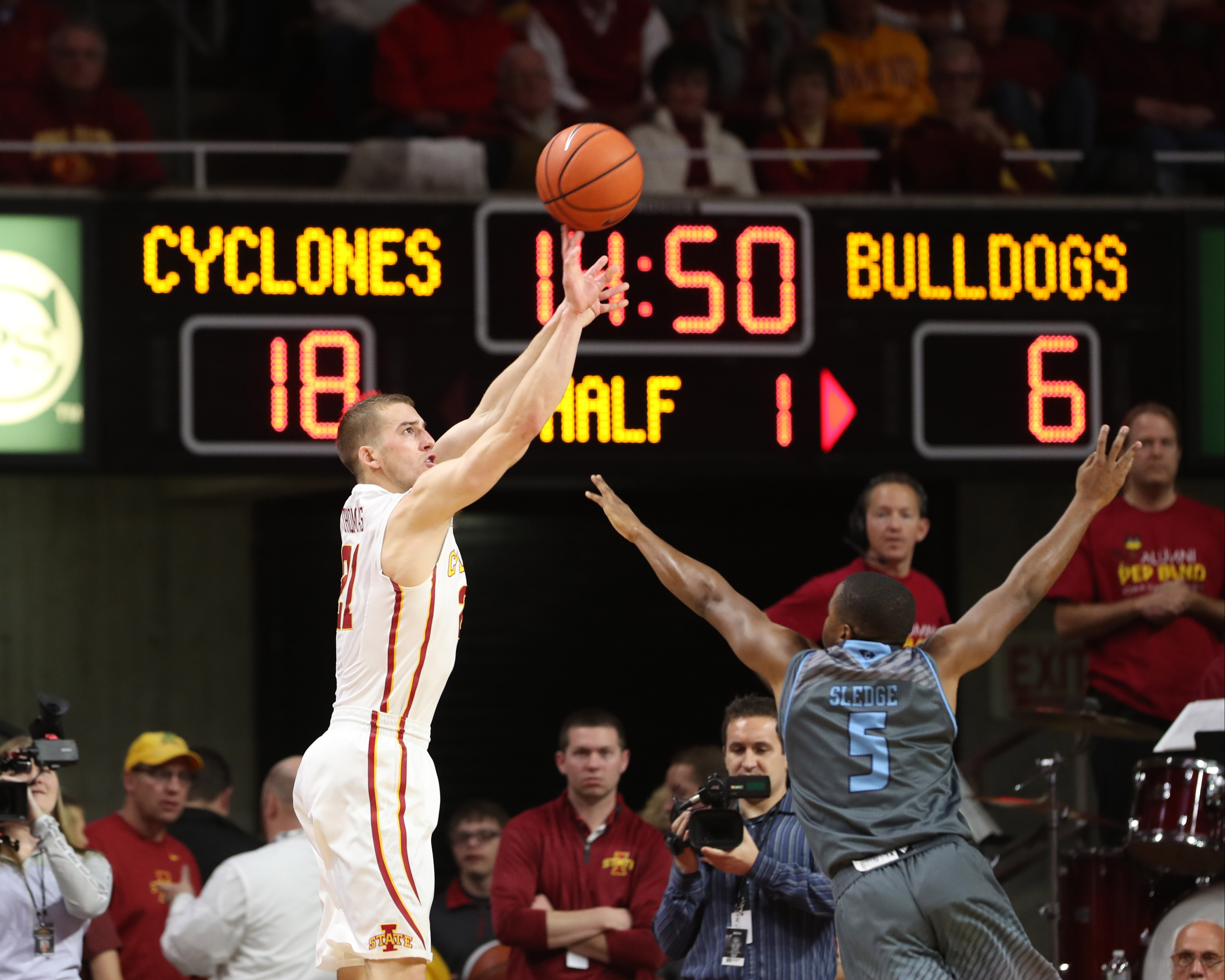 Nov 20, 2016; Ames, IA, USA; Iowa State Cyclones guard Matt Thomas (21) shoots a three pointer over Citadel Bulldogs guard Warren Sledge (5) at James H. Hilton Coliseum. Mandatory Credit: Reese Strickland-USA TODAY Sports