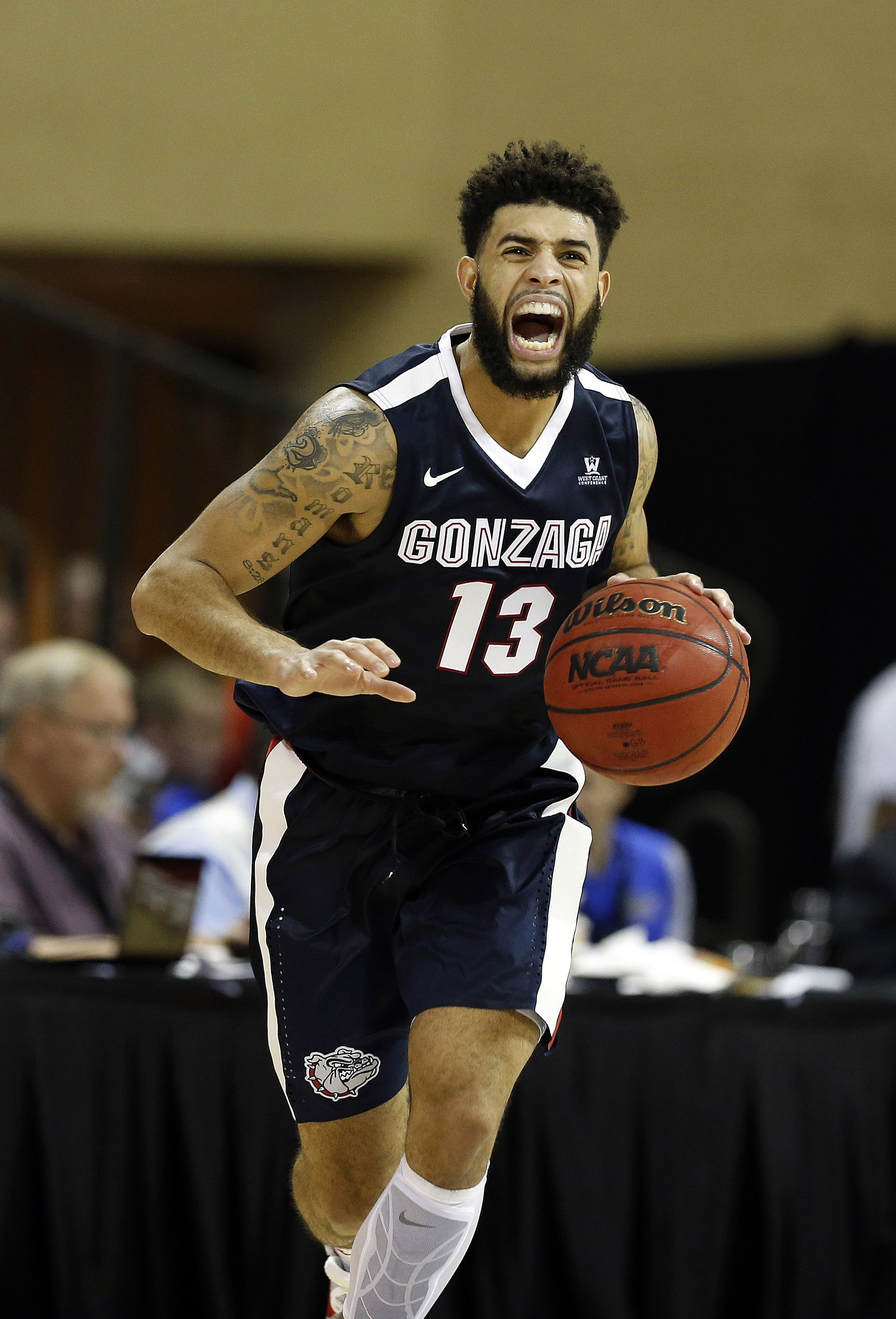 Nov 24, 2016; Kissimmee, FL, USA; Gonzaga Bulldogs guard Josh Perkins (13) drives to the basket against the Quinnipiac Bobcats during the second half at HP Field House. Gonzaga Bulldogs defeated the Quinnipiac Bobcats 82-62. Mandatory Credit: Kim Klement-USA TODAY Sports
