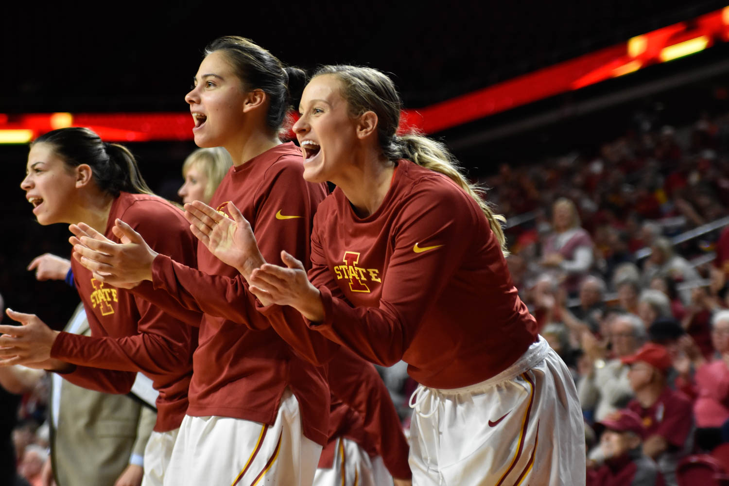Senior guard Lexi Albrecht cheers for the Cyclones at the basketball game against UNI at Hilton Coliseum on Nov. 15. ISU won 76-68. Credit: Lani Tons