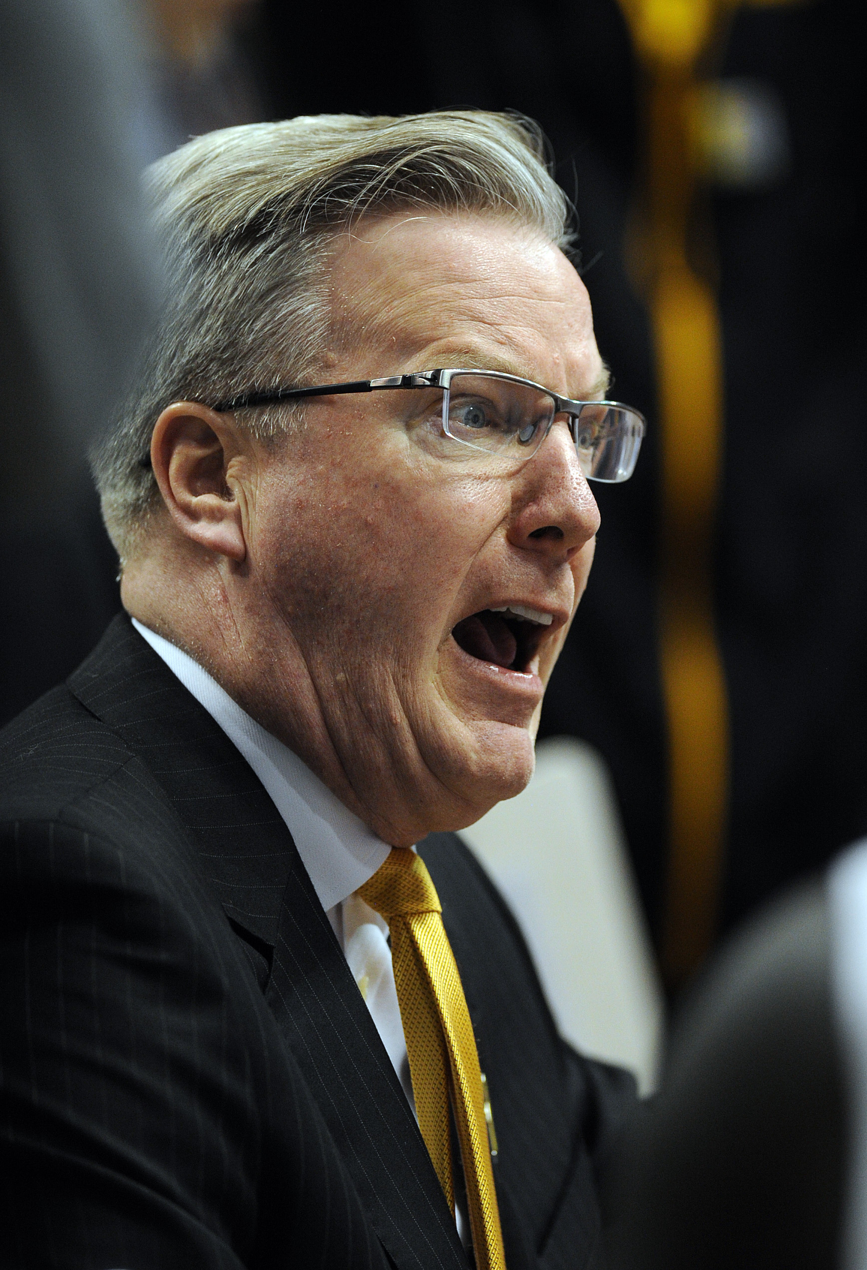 Mar 10, 2016; Indianapolis, IN, USA; Iowa Hawkeyes head coach Fran McCaffery yells at his players in a huddle during a first half timeout against the Illinois Fighting Illini during the Big Ten Conference tournament at Bankers Life Fieldhouse. Mandatory Credit: Thomas Joseph-USA TODAY Sports
